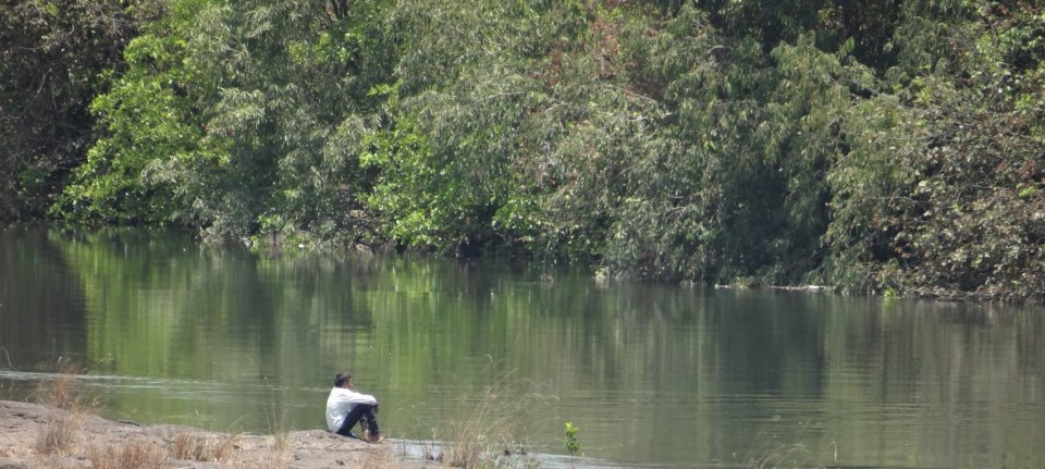 A small boy by the Bhama River when water was released into the river after a long dry spell. Photo: SANDRP