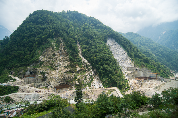 Construction of the Teesta III project at Chungthang on the edge of  Khangchendzonga National Park proceeding without SC-NBWL clearances. Note the  extensive forest cover and large landslides at the construction site.  From: SC NBWL Members Report