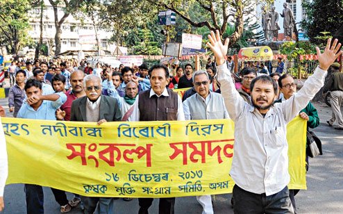 KMSS president Akhil Gogoi with other members take out a procession in Guwahati on 16th December, 2013.  Picture by UB Photos