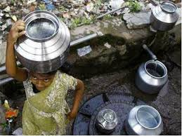 Child fetching water amidst filth. Photo with thanks from: Economic Times