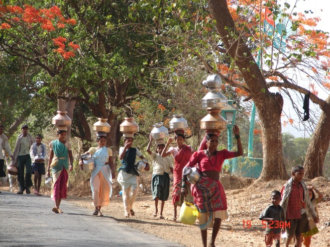 Women fetching water from far off sources even as Middle Vaitarna is close by. Photo: Parineeta Dandekar