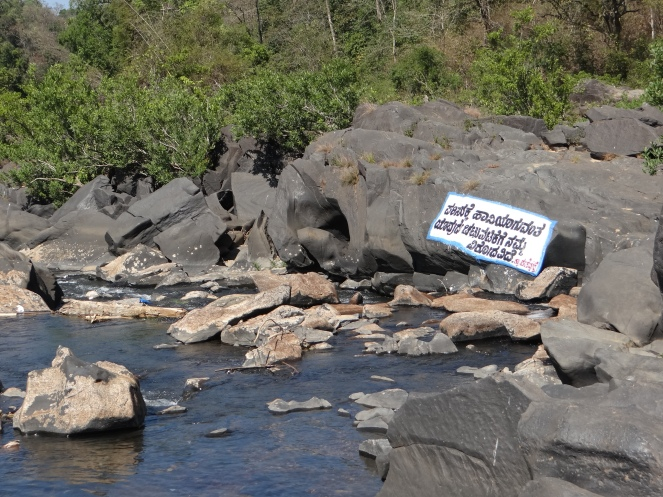 Sign on a river boulder
