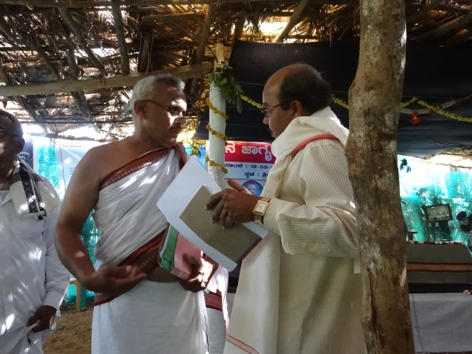 Priests earnestly discussing river protection strategies