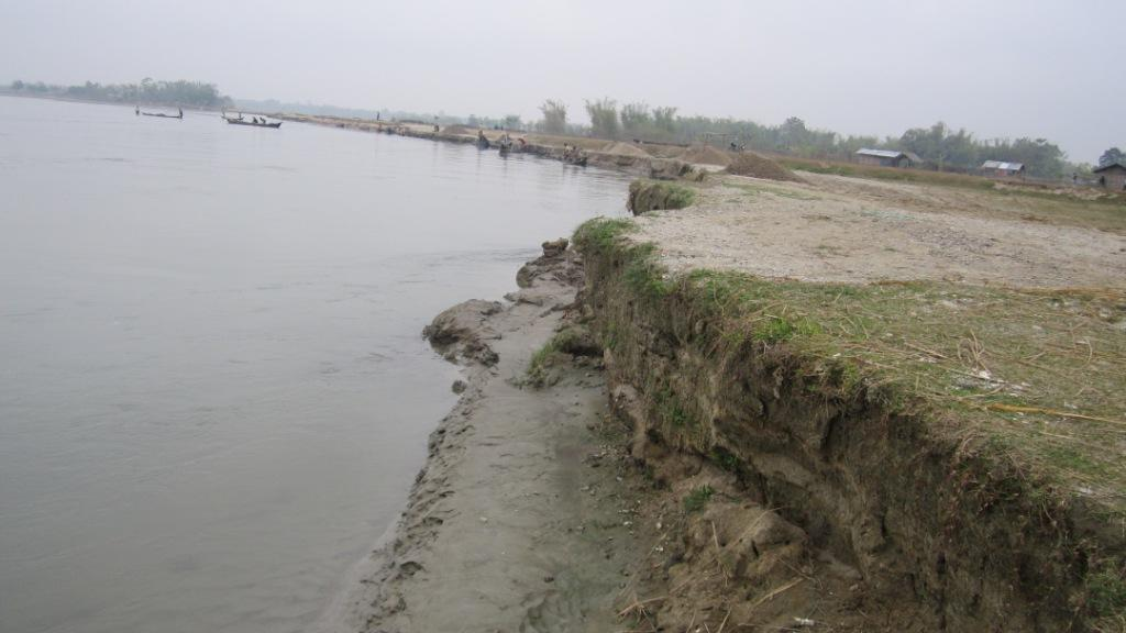 Dikrong at Dikronghat in Lakhimpur district of Assam where it erodes rapidly. The impacts of change is water flow is clearly visible. Due to release of water in upstream water at night covers the lower portion of the bank. This photo was taken around 8am in the morning when the water receded. The lower bank portion was wet in the morning. According to the local the water further recedes by the evening and again increases at night. Photo: Parag Jyoti Saikia