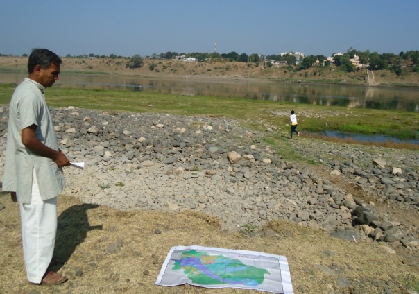 River Narmada from Indravarna village which will be affected due to  construction of Garudeshwar dam. The map on the ground speaks volumes about locked between two dams and a river in reality.