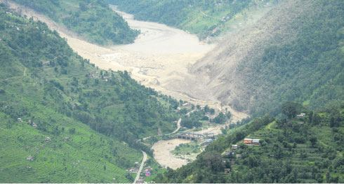 A view of water flowing out of landslide dam, photo from myrepublica.com
