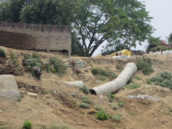 Sewage pipeline damaged by the flood of June 2013 but not repaired. When it was built, it was the pipeline to nowhere. There was no treatment plant constructed at its terminus in Ramana Village along the river bank and upstream of the Nagwa drain