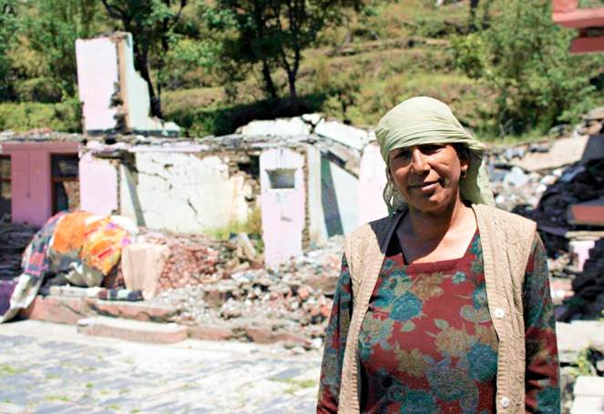 Vidya Devi's house in Mokhar  was completely damaged by the landslide caused due to the seepage from the surge shaft in April 2012