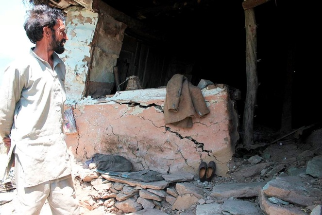 People of Dhalanjan village show their destroyed and dilapidated structures