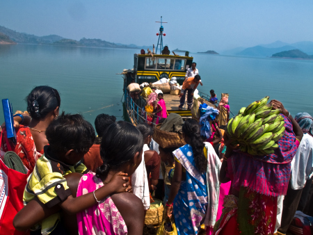 tribals trying to get aboard the only motor launch thats their link to the main land after being cut off by Machkund and Balimela Dams. Photo from : http://moonchasing.wordpress.com/2010/03/14/forgotten-country-the-cut-off-area-of-malkangiri/