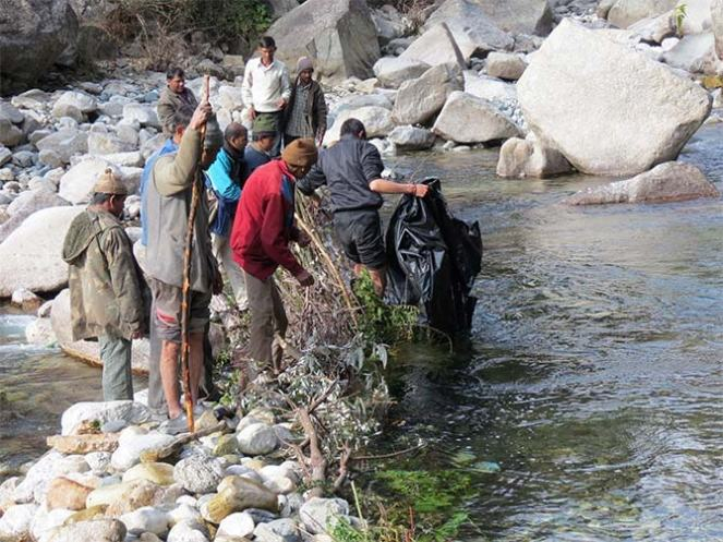 Yogeshwar Kumar and his team setting up micro hydel projects in Uttarakhand for local power. Photo: Rediff