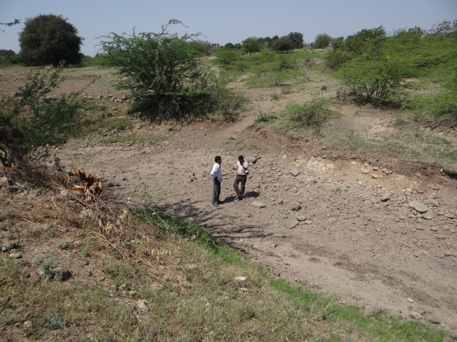 Macchindra with a farmer who is affected by a tunnel which is a part of the Krishna Marathwada project. Photo: Author