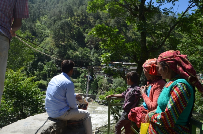 Villagers waiting for ropeway trolley where a  foot bridge at middle Kharadi washed away in June 2013