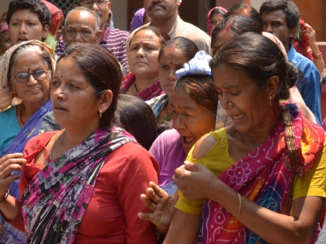 Village women showing cloth torn by police during lathi charge