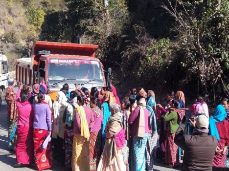 Maletha women stopping truck from transporting stones to crusher units