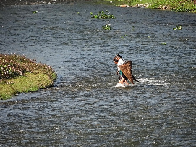Ladies off fishing in a tributary of Tengapani River in Arunachal Pradesh