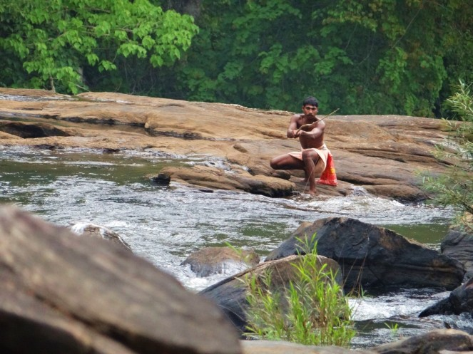 Kadar tribesman fishing in the Chalakudy River in Kerala Western Ghats, just downstream the site of the proposed 163 MW Athirapilly Hydropower Project. Challakudy is an extremely fish rich river and its last flowing refuge will be destroyed by the HEP