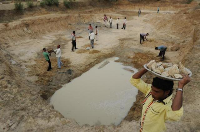 Villagers of Uka at Raghunathpur-II block in Purulia district dig a catchment area for rainwater harvesting