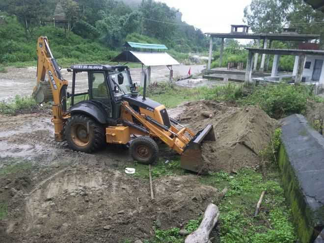 a-jcb-machine-dismantles-road-leading-to-the-bed-of-the-neugal-river-in-sulaha