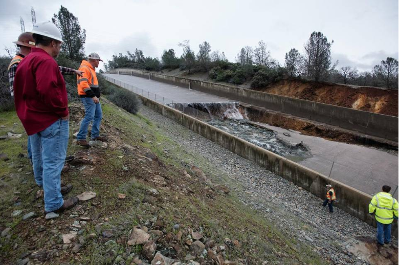 Engineers inspecting the damaged spillway of Oroville Dam (Media reports in USA)