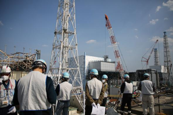 Reporters visit the crippled Fukushima Daiichi nuclear plant on April 14, 2017, in northeastern Japan. The disaster there has increased anxiety about such large projects among investors