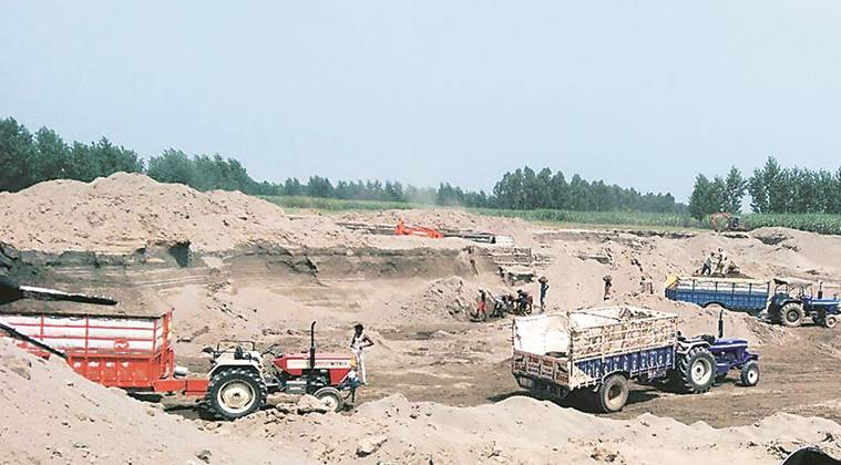 Sand being mined from a dry riverbed in Amritsar district