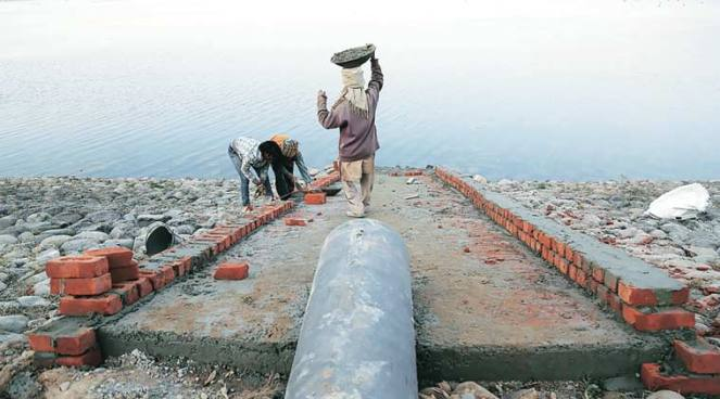 Pipe being laid to artificially fill Sukhna Lake in Chandigarh on January 12. (Express Photo by Jaipal Singh)