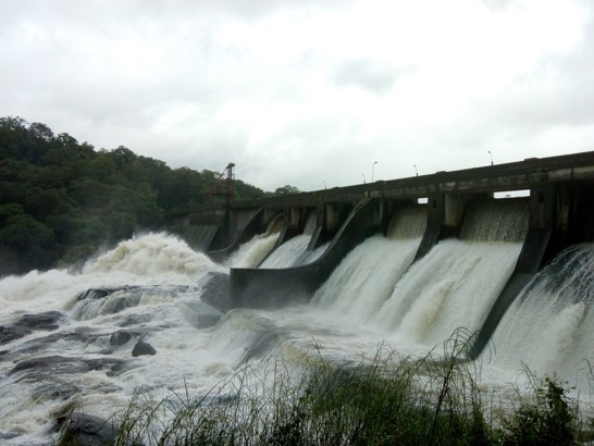 Two weeks before the flood – 26th July 2018 Water spilling over the gates of Poringalkuthu Reservoir, Chalakudy River, Kerala Madhu