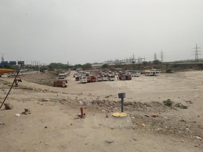 Parking facility in Yamuna floodplain at Garhi Mandu.