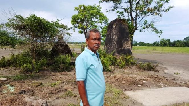Bipin Pegu infront of his ancestral burial site