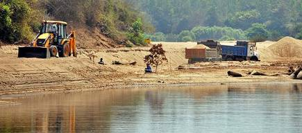 Sand mining at Extraction of sand on Tunga river near Chibbalagudde fish sanctuary