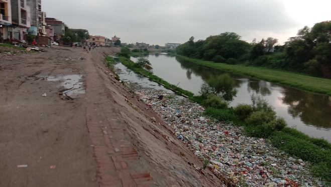 July 21, 2020 pic showing drain no. 6 (left) choked with solid waste, while drain no. 8 (right) flowing next to it. (Bhim Singh Rawat)